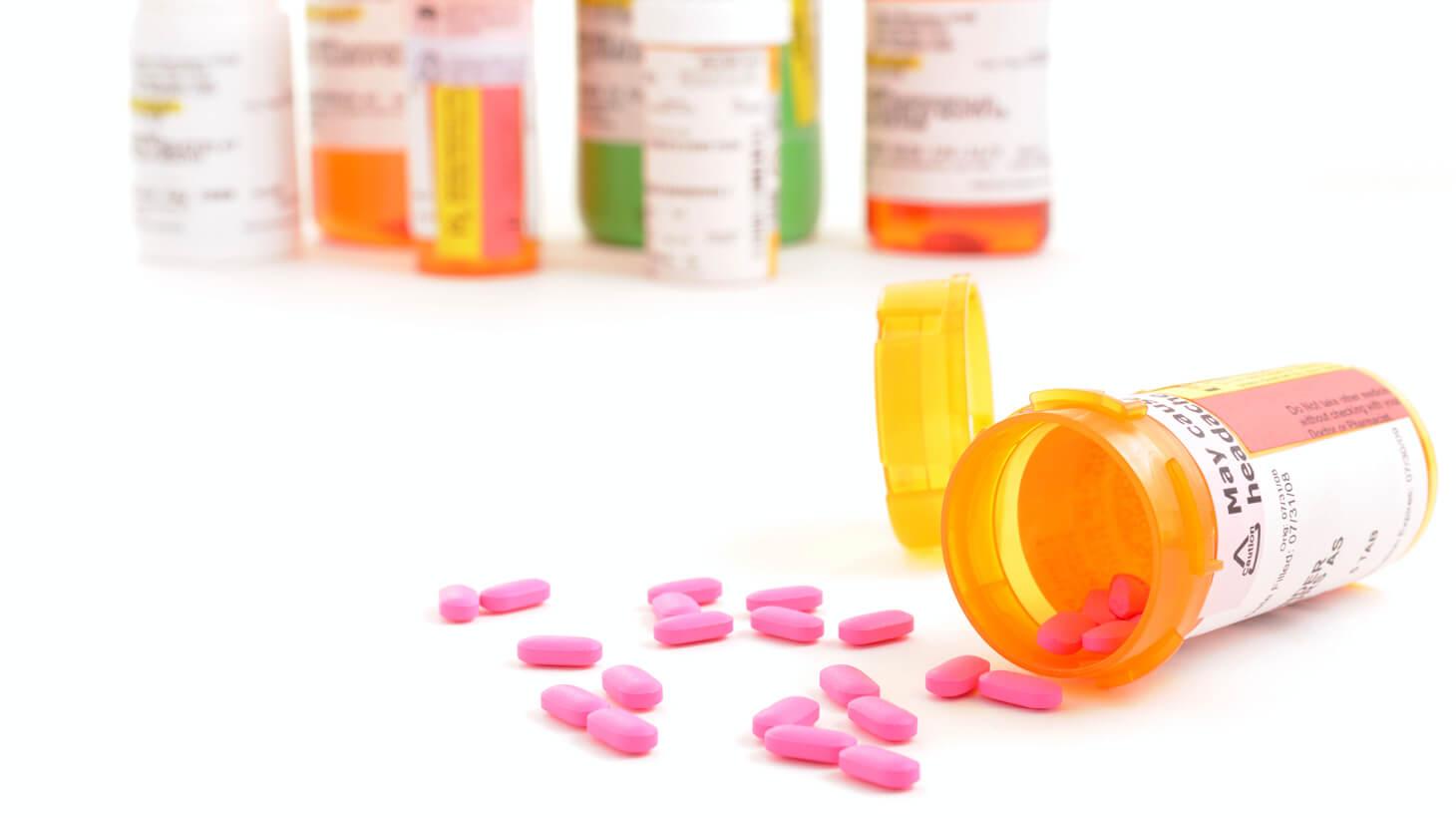 Prescription pill bottles and pink pills